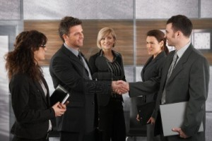 6711491-happy-businesspeople-shaking-hands-greeting-each-other-before-business-meeting-in-office